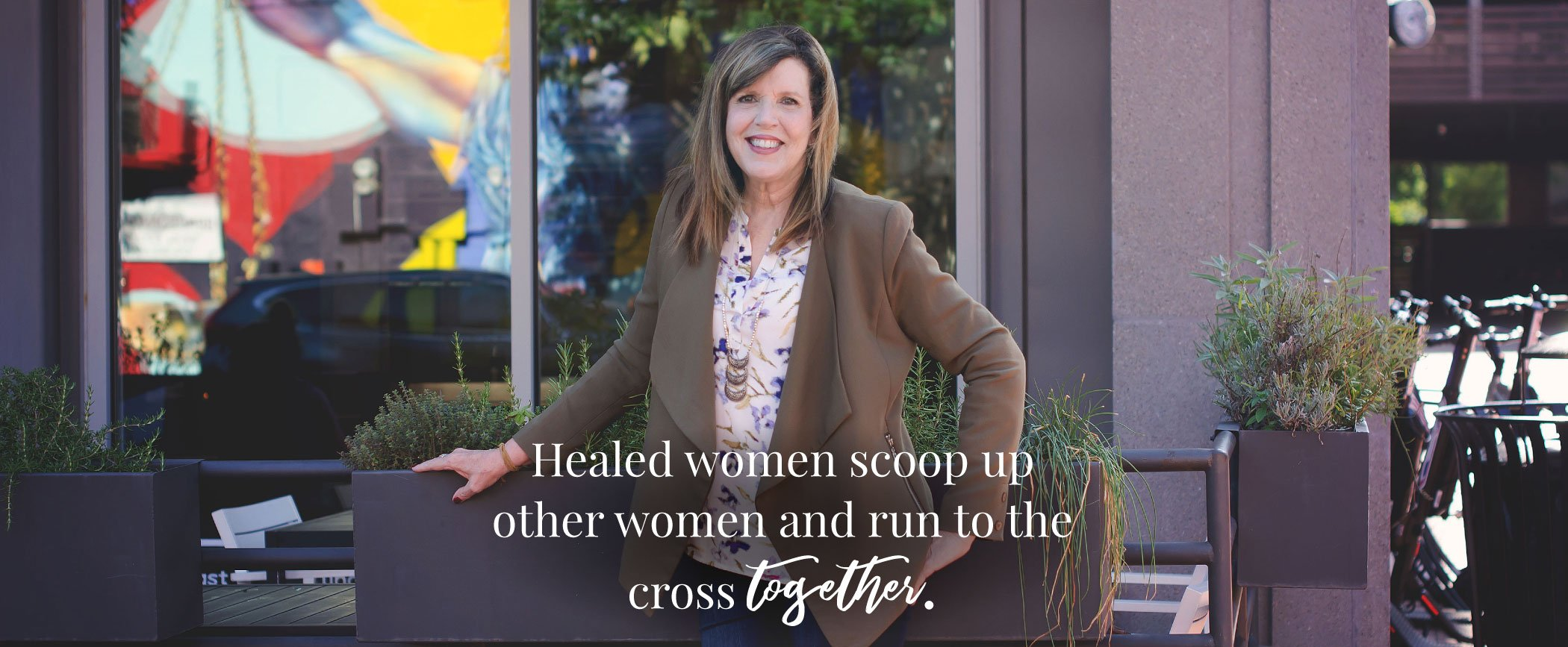 Suzie smiling - Healed women run to the Cross together